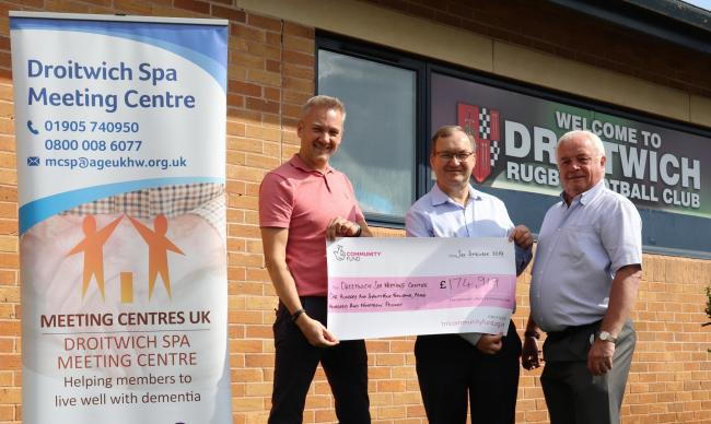 BOON: From left, Greg Westwood of the National Lottery presents the cheque to Mike Watts and Derek Radcliffe of the centre.