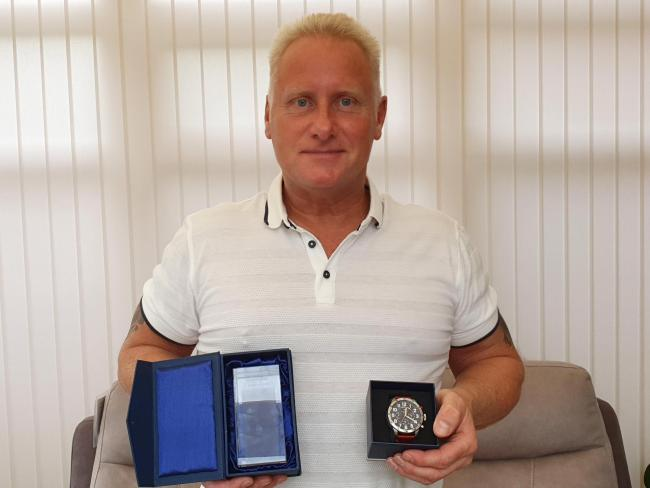 WIN: Pete Graham,56, from Droitwich with his watch and winning medal