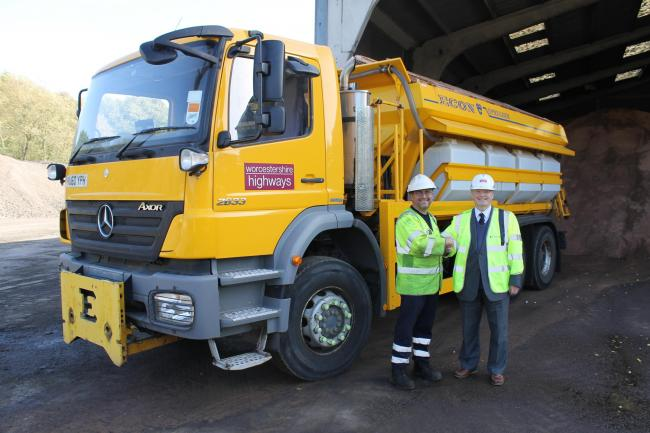 Juan Ortiz, from the Stanford depot, and Councillor Alan Amos with one of the gritters