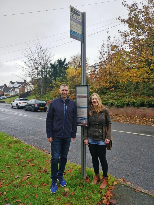 SAVED: Cllr Andy Stafford (left) with local resident Jules Benham at a bus stop in Old Northwick Lane