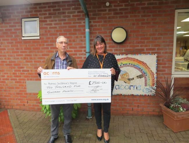 Richard Webster presents his cheque to Acorns fundraiser Mel Hall
