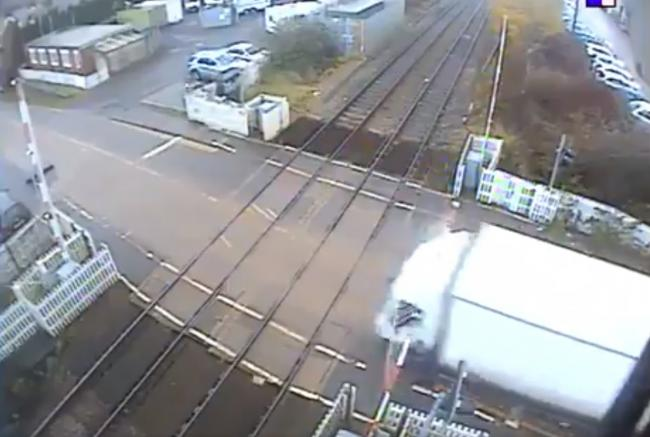 CRASH: The lorry crashes through a level crossing barrier. Picture: Network Rail
