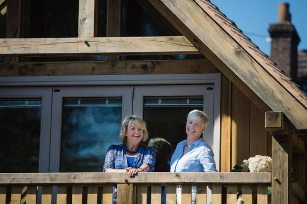 Redditch Advertiser: Little Lodge owner Samantha Parr (left) and architect Andrea Millner on the balcony of the award-winning house. Pic by Lyndon Darkes