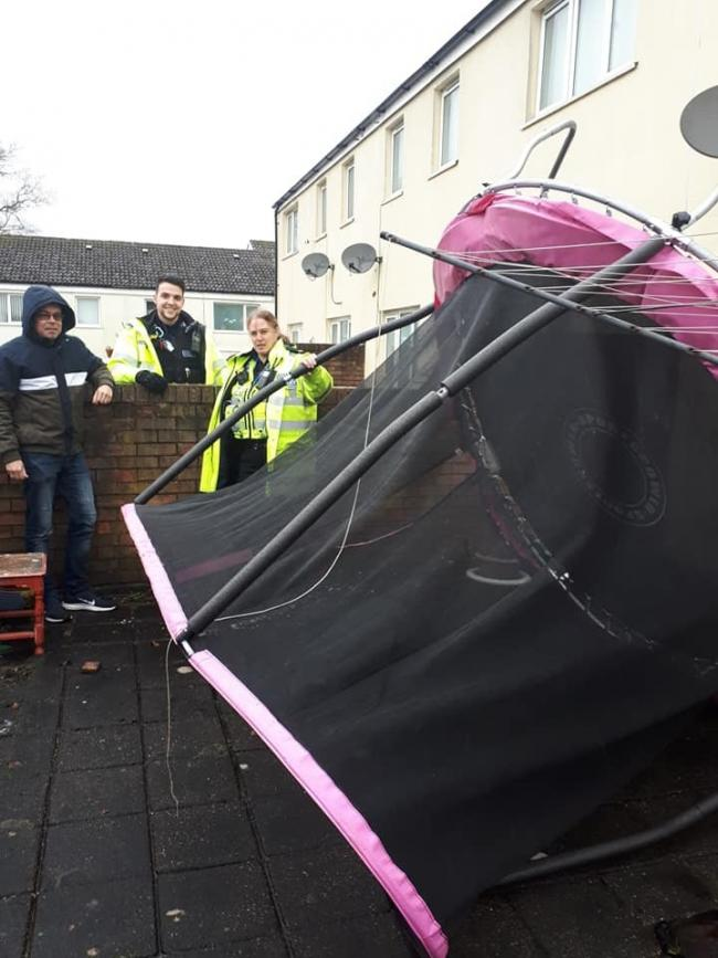 Police in Redditch assisting a resident with a uninvited trampoline