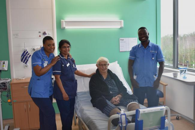 OPEN: The first patient in the new wards, Alan Hartley, with staff.