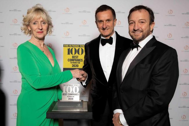 Spencer McCarthy and Clinton McCarthy pick up their award from Karen Robinson at Sunday Times