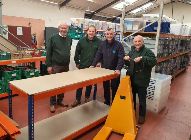 Surprise in store - Hannafin's Ciaran Considine presents some of the new shelving, storage units and pallet truck to food bank volunteers Roy Walford, Paul Clarke and manager Grahame Lucas.