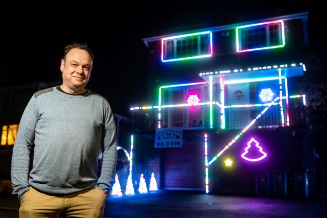 Nick Wright with his spectacular Christmas lights display. The barrister has put them up nine months early to bring joy to people during the coronavirus pandemic. Photo by SWNS