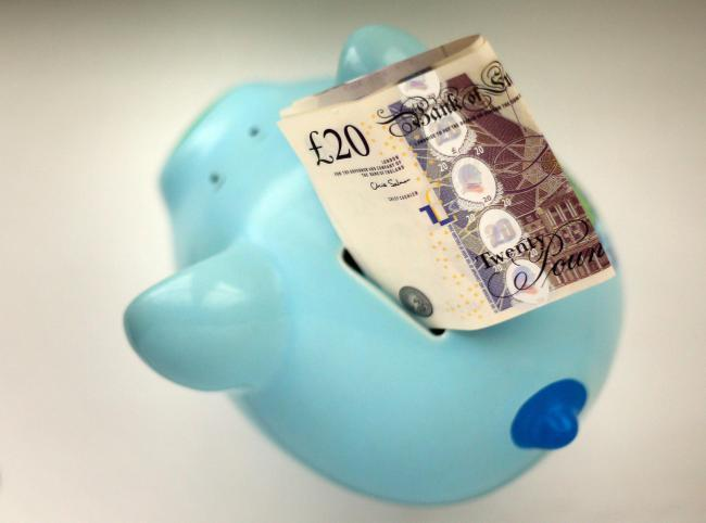 PIGGY BANK: Furlough - How the workers scheme works - and if you still have to pay taxes. Picture: PA Wire.