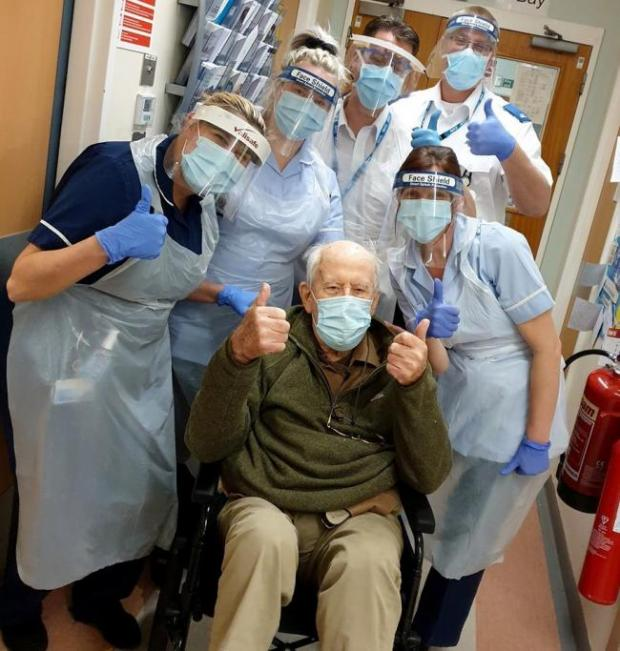 Redditch Advertiser: Coronavirus survivor 101-year-old Keith with staff at Ward 12 at Alexandra Hospital in Redditch