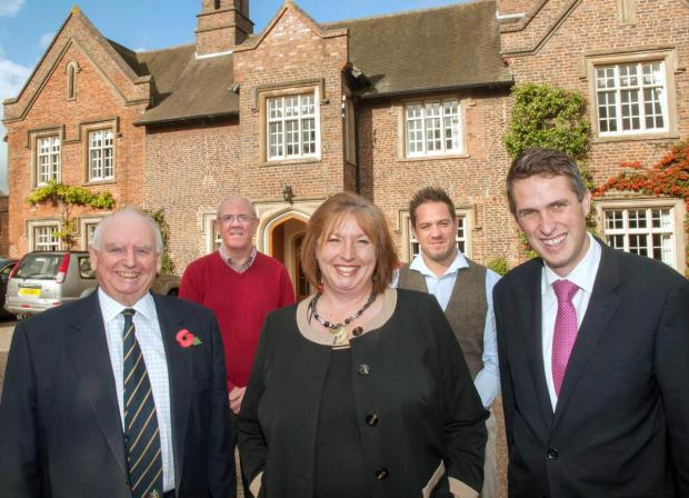 Redditch Advertiser: Terrie Beardsmore, centre, with Cllr Brian Edwards, left, Gavin Williamson MP, right, and Wilf and Simon Beardsmore, back.