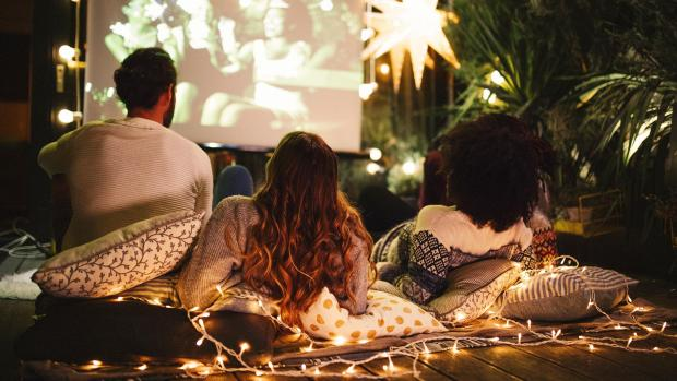 Redditch Advertiser: Sit back and relax with a projector and outdoor screen. Credit: Getty Images / M_A_Y_A