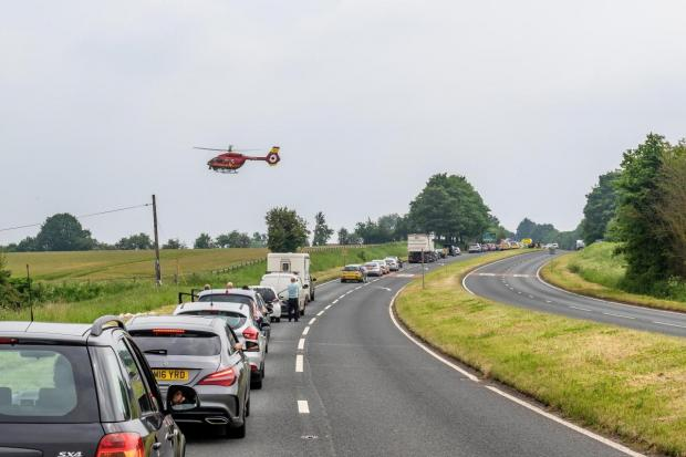 Redditch Advertiser: The air ambulance landing near to the scene of the crash in May 2018. Photo by Paul Hickey