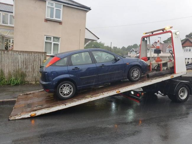 The car was towed away by police