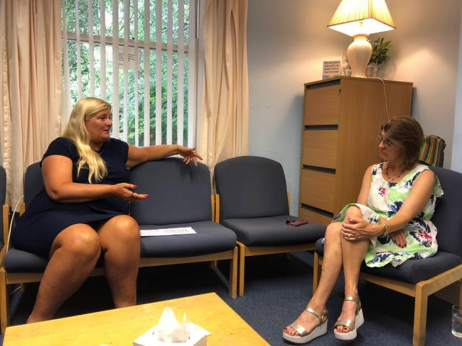 Lee McKenzie from the Sandycroft Centre and Redditch MP Rachel Maclean