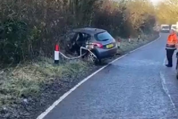 A car is pulled out of a bush after a crash in Beoley, Redditch. Picture: @OPUWorcs