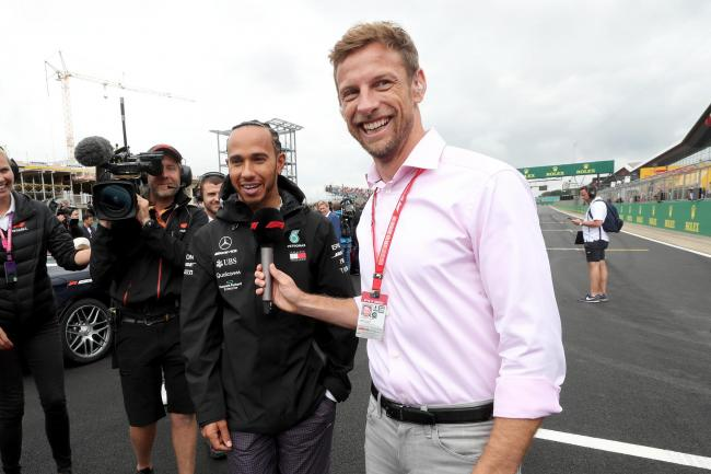 Jenson Button (right) interviews Lewis Hamilton (left)