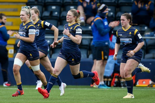 Lydia Thompson (middle) in action for Worcester Warriors Women v Bristol Bears Women. She starts for England this weekend in the Women's Six Nations opener against Scotland. Pic: JMP