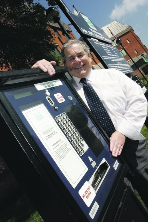 Councillor Bill Hartnett at one of the town's pay and display machines. Buy this photo RCR381201_a