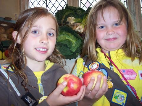 Maddie Brocklebank and Hollie Hutton of 2nd Studley (St. Mary's) Brownies with some delicious produce