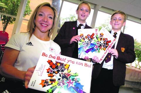Anna Turney with pupils Emily Mills, 12, and Ellis Beesley, 13. Buy this photo RMM401208a