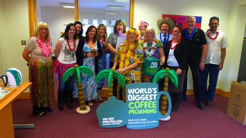 Staff at Alpha Care Homes head office raise charity cash Hawaiian style