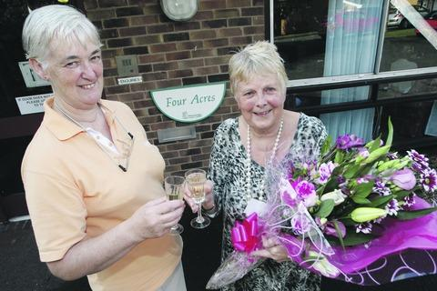 Penny Caulwell and Christine Franklin celebrate their retirement from Four Acres Nursing Home. Buy photo: RCR411201_a at redditchadvertiser.co.uk/pictures or call 01527 889030.