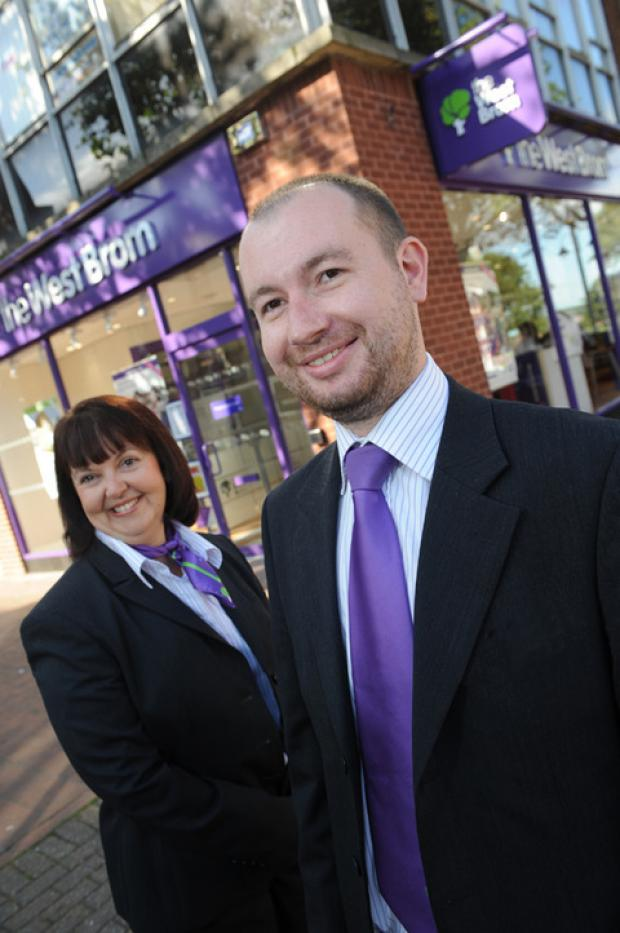 Mark Adams and Debbie Williams outside the new West Brom branch.