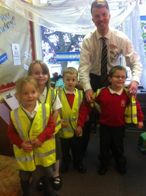 Youngsters from Harry Taylor First School with Craig Evans from Specsavers