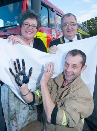 Textile artist Kim Thittichai, firefighter Craig Pillinger, and Redditch mayor Alan Mason