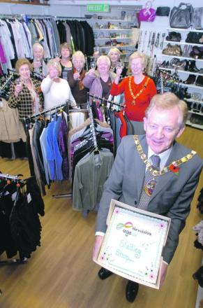 Councillor Neville Beamer, Stratford District Council chairman, with volunteers from the shop. Buy this photo RMM471202a