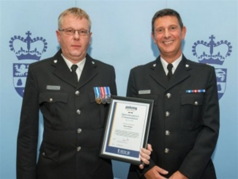 PC Simon Worley receiving his award from Superintendent