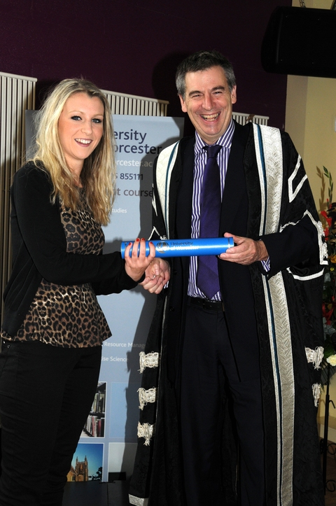 Laura Forty receiving her award from University of Worcester vice chancellor professor David Green
