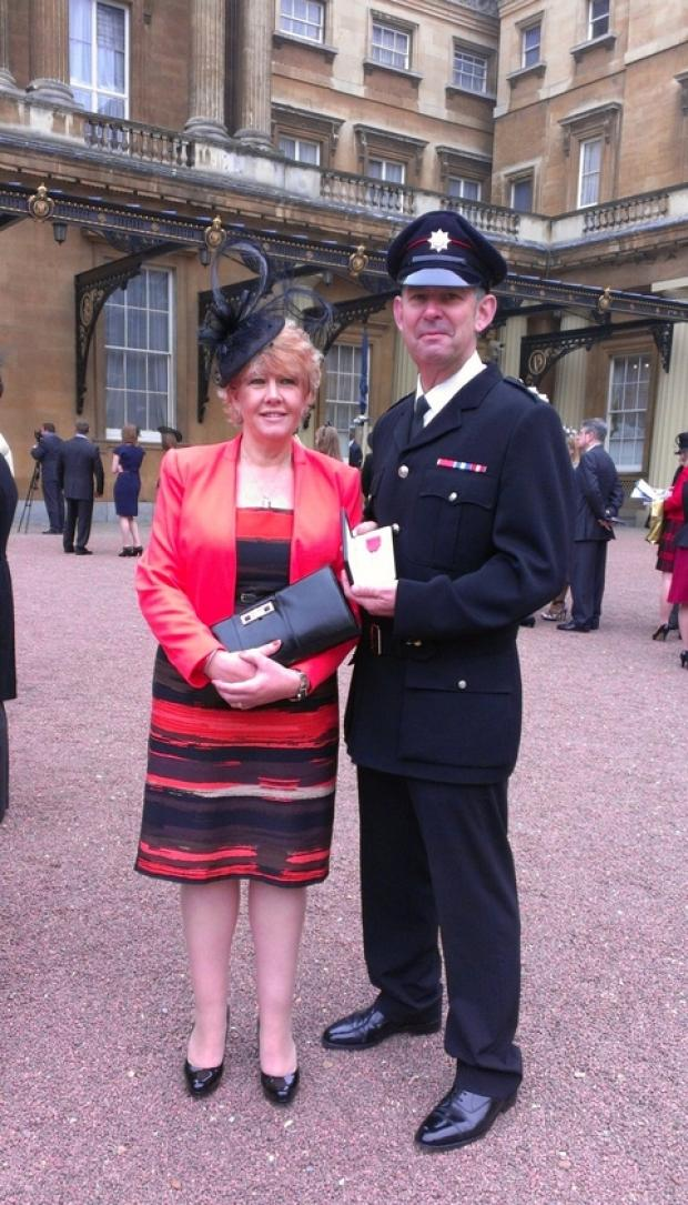 Watch commander Ade Taylor and his wife Sue outside Buckingham Palace.