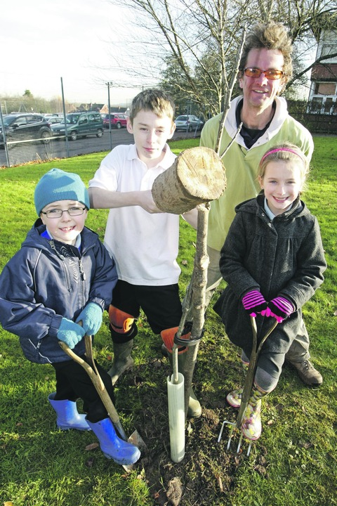 Planting a new orchard: (from left) David Ennis from St Stephen's First School, Zac Cavey from The Forge, community gardener Alistair Waugh, and Lucy Johnson from St Stephen's First School. Buy photo: RCR501201a.