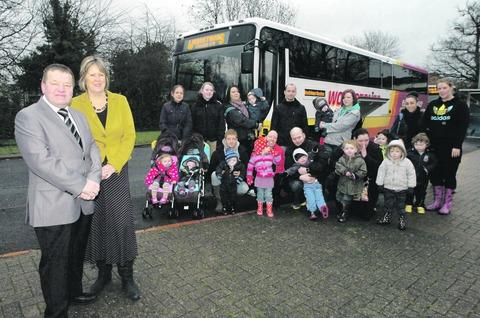 Councillors Brandon Clayton and Jane Potter, with children, family and staff from Woodlands Sure Start Centre heading off to Dodford Children's Farm. Buy photo: RMM501201a.