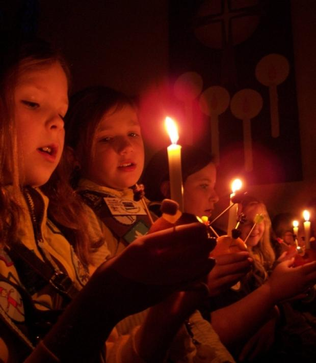 Brownies Emma Winfield and Isabel Parker with Christingle's.