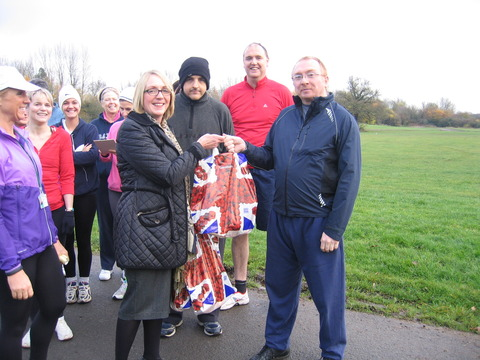 Sharon Neal, Redditch Sainsbury's manager, congratulates runner Martyn Groves as borough council instructor Lee-Ann Dixon (left) and members of the Couch to 5K group.