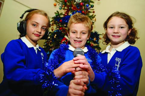 Mia Browning, Taylor Edes and Nicola Steward get into the spirit of Christmas at Studley St Mary's CE Junior School.