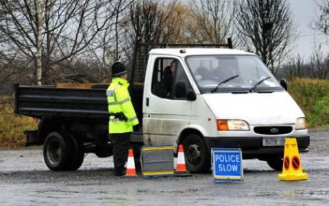 CRACKING DOWN: Police stop drivers during their bid to keep the roads safe.