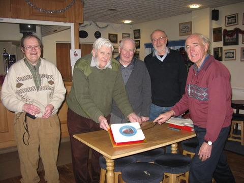 Members of Redditch Railway Interest Group cut a celebratory cake
