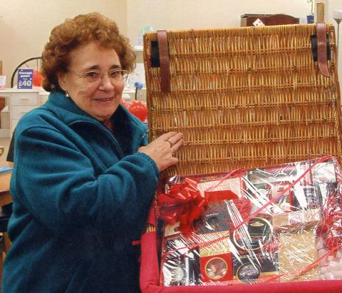 Raffle winner Marguerite Day receives her superb hamper.