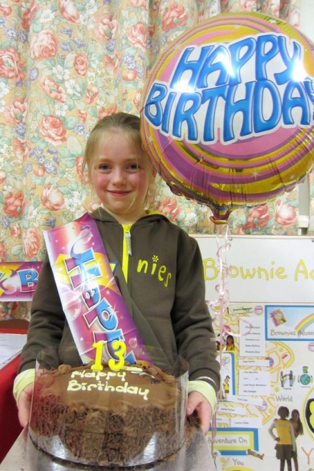 Olivia Blizzard, aged eight, with the celebratory cake