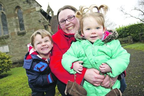 Redditch Advertiser: Kate Jervis with children Owen and Evelyn at St Philip's Church. Buy this photo RCR313