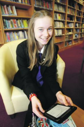 Helen Scarle, aged 13, a student librarian, in the newly refurbished Kingsley library