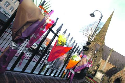 Tributes: Flowers left in Church Green for Mr Wiseman