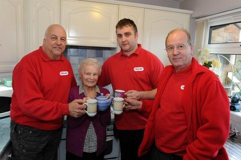 Resident Mabel Harris with npower engineers Steve Cashmore, Carl Parry and Keith Boote