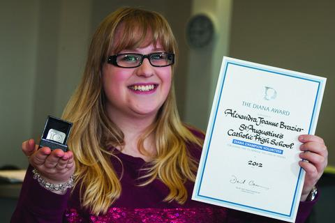 Alex Brazier with her award, signed by PM David Cameron