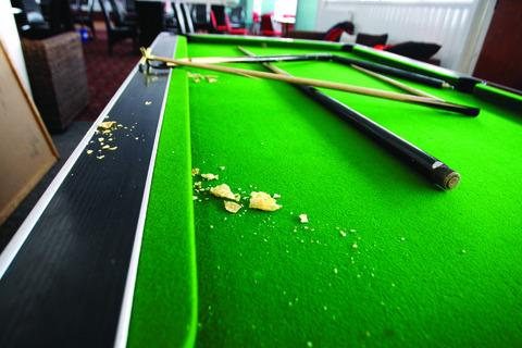Pools cues were broken and the club was littered with mess.