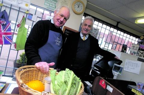 John Calvert, chairman of Feckenham Community Shop, and county councillor Philip Gretton admire the shop's new till system. Buy photo: RMM051308b